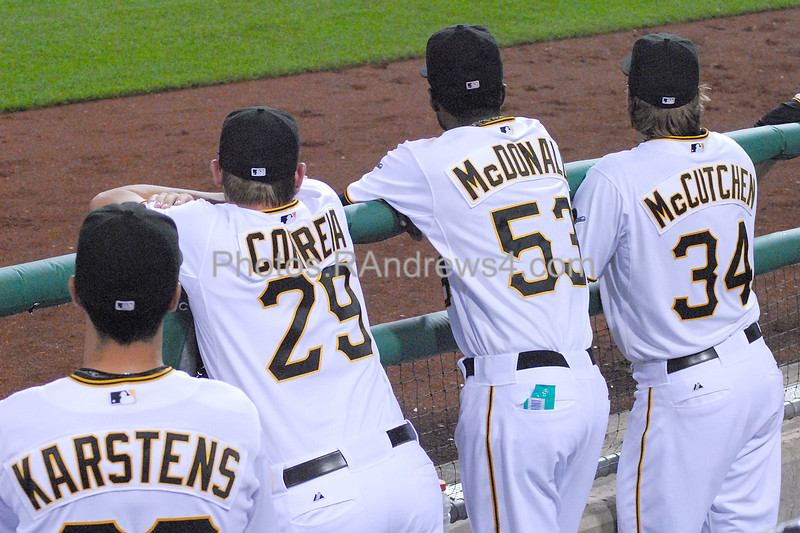 Pirate pitchers Karstens, Correa McDonald, and McCutchen are up on the dugout rail cheering on their team mates.