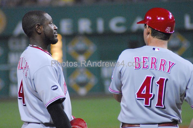 Cincinnatti Reds second baseman Brandon Phillips (#4) talks to third base coach Mark Berry (#41).