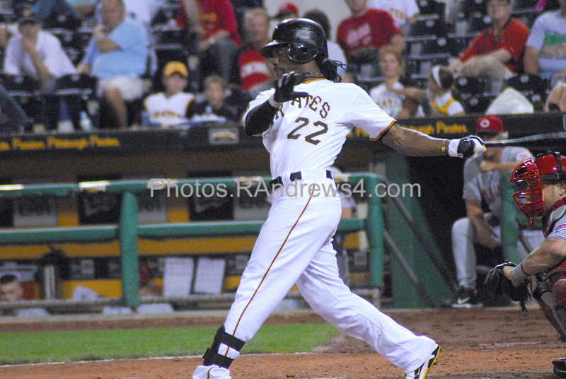 Pittsburgh Pirates center fielder Andrew McCutchen fouls off the pitch as catcher Ramon Hernandez looks on.