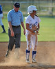 #2 Kaitlin McGinley brushes off the dust after her slide into 2nd base.