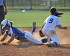 #19 Shanti Poston receives the throw from Villalpando to tag Bethel runner Danielle Reilley, but not in time.