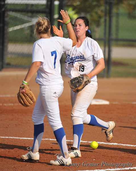 #7 Alex Miller and #19 Shanti Poston celebrate the last out of the 2nd inning.
