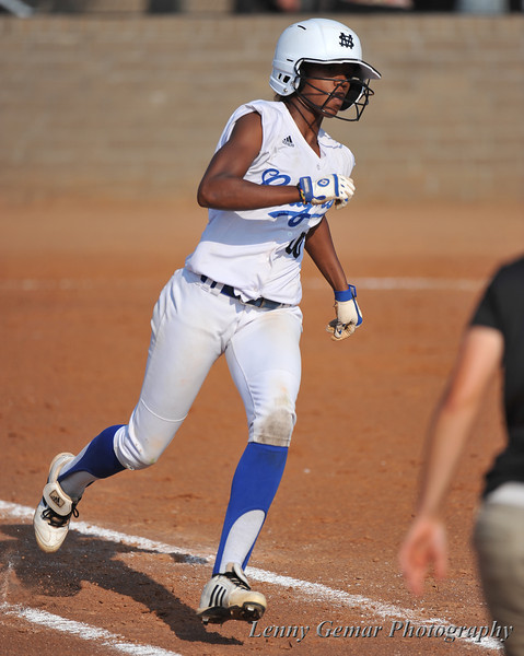 #00 Derrisha Lacey singles up the middle.