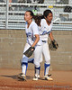 #1 Brenna Sandberg and #3 Heavin-lee Rodriguez after Rodriguez catches the 3rd out.