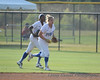 #00 Derrisha Lacey and #7 Alex Miller run to the dugout after Miller makes the last out of the 4th inning.