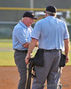 For 13 minutes, the umpires, coaches, and tournament director will discuss the validity of the interference call against Ingram.  In the end, the call will stand, and Ingram will be the 3rd out of the Cougars' 7th inning.