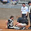 Morningside's catcher MacKenzie Neely recovers from her collision at the plate.