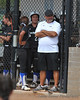 #22 Theresa Houle and asst. coach John Coelho in the dugout.