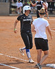 #7 Alex Miller walks and is greeted by CSUSM Asst Coach Leah Glasgow at 1st..