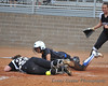 Morningside's catcher, who has reached out to block the plate, collides with #9 Patricia Banda. It appears that Banda's left shoulder may have hit the catcher in the face.