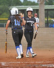 #18 Kimberly Villalpando, driven in on a double by Heavin-lee Rodriguez, is seen here welcoming #2 Kaitlin McGinley to the plate.