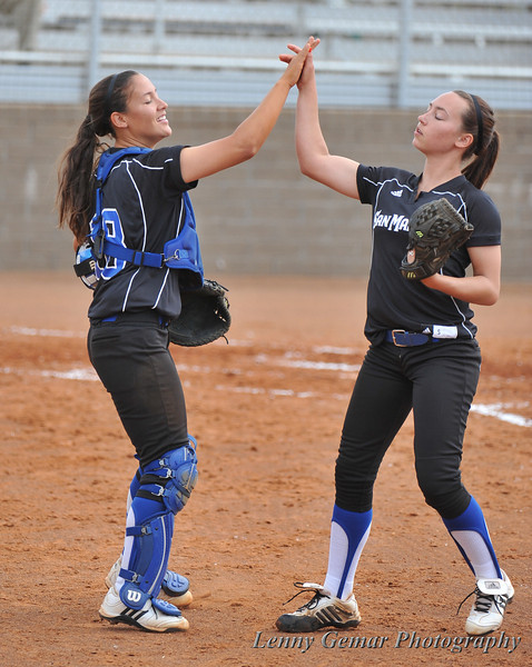 Catcher #18 Kimberly Villalpando greets pitcher #1 Brenna Sandberg after the last Morningside batter is struck-out looking.