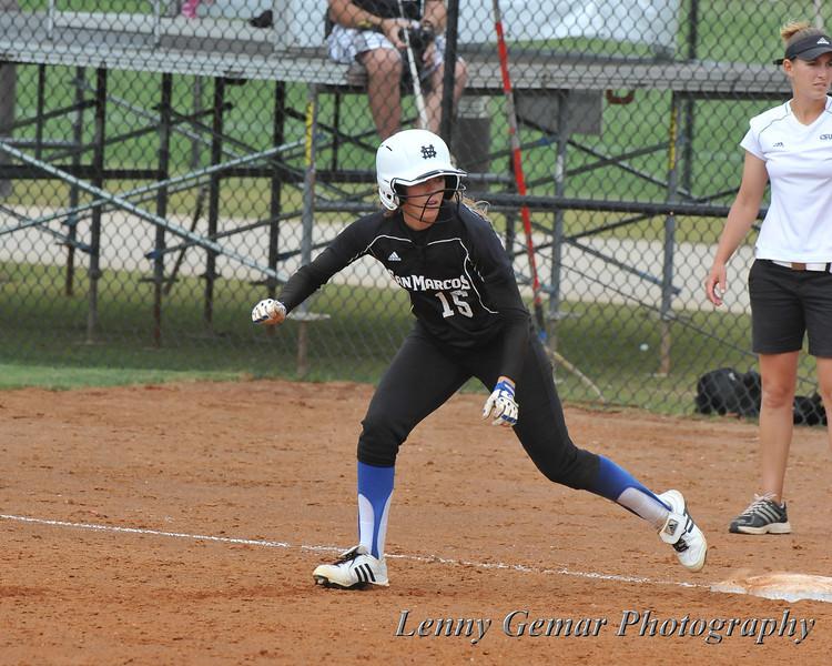 #15 Alicia Ingram at 1st base.