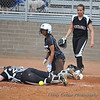 Down for the count, the Morningside catcher lays still at the plate as  #9 Patricia Banda arises like a Phoenix from the ashes after scoring CSUSM run #3.
