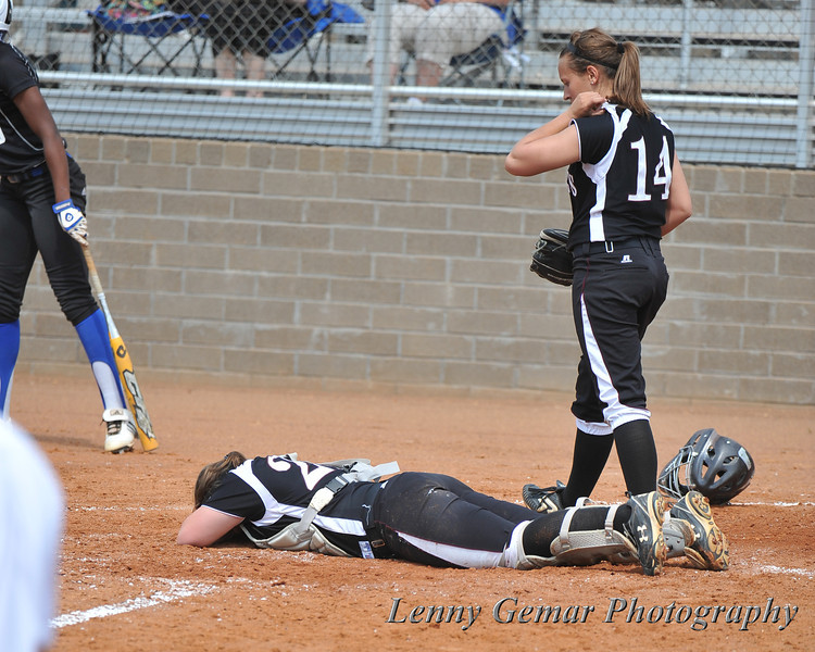 Morningside's catcher grieves over her dropped ball.