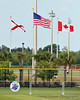 Flags over the ballpark.  The 2011 NAIA Tournament of Champions held in Gulf Shores Alabama, flies flags for the state of Alabama, the United States, and for Canada.