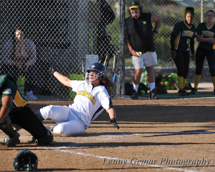 Sliding home to win the game.