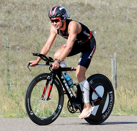 "Boulder Ironman winner, Joe Gambles, finishes the bike leg of the race on Sunday.<br /> For  more photos and a video of the Ironman, go to  <a href=""http://www.dailycamera.com"">http://www.dailycamera.com</a>.<br /> Cliff Grassmick  / August 5, 2012"