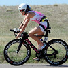"Liz Blatchford finishes the bike portion of the Boulder Ironman on Sunday.<br /> For  more photos and a video of the Ironman, go to  <a href=""http://www.dailycamera.com"">http://www.dailycamera.com</a>.<br /> Cliff Grassmick  / August 5, 2012"