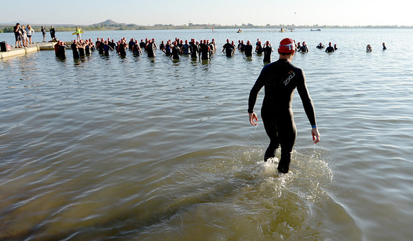 """A straggler  regroups with one of the early waves of the Boulder Ironman on Sunday.<br /> For  more photos and a video of the Ironman, go to  <a href=""""http://www.dailycamera.com"""">http://www.dailycamera.com</a>.<br /> Cliff Grassmick  / August 5, 2012"""