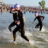 """Joe Gambles, center, comes out of the water. He would later win the Boulder Ironman on Sunday.<br /> For  more photos and a video of the Ironman, go to  <a href=""""http://www.dailycamera.com"""">http://www.dailycamera.com</a>.<br /> Cliff Grassmick  / August 5, 2012"""