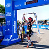 "Joe Gambles finishes the race at the Ironman Triathlon Sunday morning by Boulder Reservoir. August 5, 2012. Rachel Woolf/ For the Daily Camera. For more photos and a video of the race, go to  <a href=""http://www.dailycamera.com"">http://www.dailycamera.com</a>."