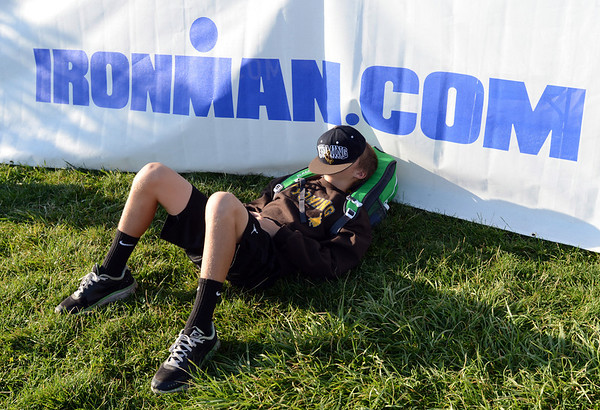 "Cole Vanmeveren takes a nap while his father competes in the Boulder Ironman at the Boulder Reservoir on Sunday.<br /> For  more photos and a video of the Ironman, go to  <a href=""http://www.dailycamera.com"">http://www.dailycamera.com</a>.<br /> Cliff Grassmick  / August 5, 2012"