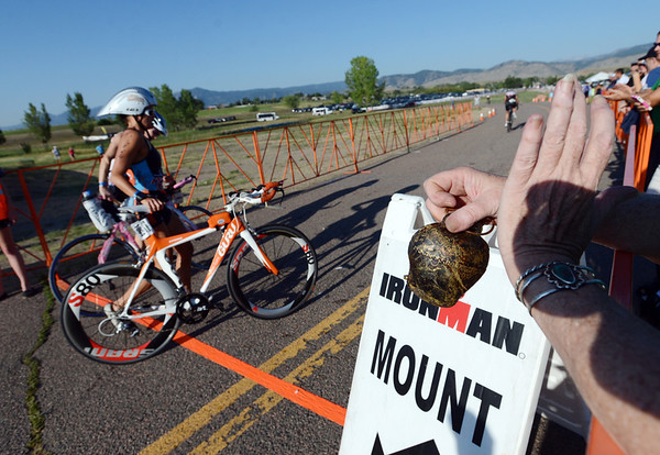 "Jonell Davis, right, rings a real cowbell to encourage racers beginning the bike segment.<br /> For  more photos and a video of the Ironman, go to  <a href=""http://www.dailycamera.com"">http://www.dailycamera.com</a>.<br /> Cliff Grassmick  / August 5, 2012"
