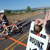 """Jonell Davis, right, rings a real cowbell to encourage racers beginning the bike segment.<br /> For  more photos and a video of the Ironman, go to  <a href=""""http://www.dailycamera.com"""">http://www.dailycamera.com</a>.<br /> Cliff Grassmick  / August 5, 2012"""