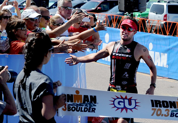 "Joe Gambles wins the 2012 Boulder Ironman on Sunday at the Boulder Reservoir.<br /> For  more photos and a video of the Ironman, go to  <a href=""http://www.dailycamera.com"">http://www.dailycamera.com</a>.<br /> Cliff Grassmick  / August 5, 2012"
