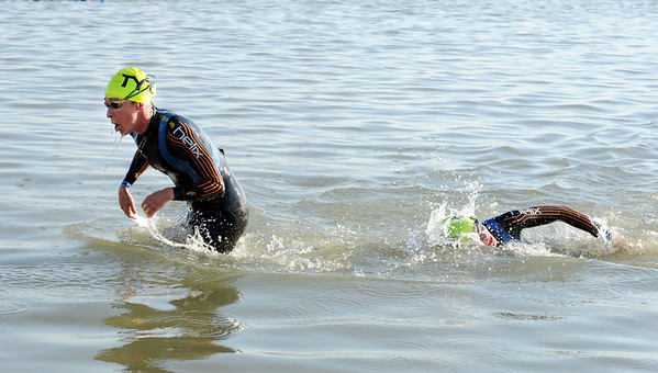 "The first two pro women come out of the water at the Boulder Ironman on Sunday.<br /> For  more photos and a video of the Ironman, go to  <a href=""http://www.dailycamera.com"">http://www.dailycamera.com</a>.<br /> Cliff Grassmick  / August 5, 2012"