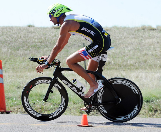 "Matt Reed finishes the bike leg of the pro race on Sunday.<br /> For  more photos and a video of the Ironman, go to  <a href=""http://www.dailycamera.com"">http://www.dailycamera.com</a>.<br /> Cliff Grassmick  / August 5, 2012"