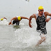 "Dylan McNeice, right, was the first out of the water in the men's pro division.<br /> For more photos and a video from the Peak Triathlon, go to  <a href=""http://www.dailycamera.com"">http://www.dailycamera.com</a>.<br /> Cliff Grassmick / July 8, 2012"