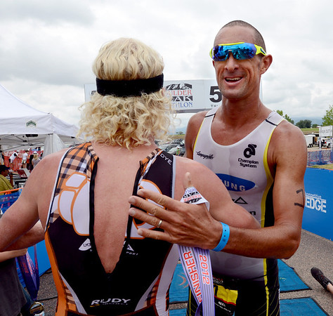 "Boulder Peak winner, Cameron Dye, left, is congratulated by second place finisher, Matt Reed in the Boulder Peak Triathlon on Sunday.<br /> For more photos and a video from the Peak Triathlon, go to  <a href=""http://www.dailycamera.com"">http://www.dailycamera.com</a>.<br /> Cliff Grassmick / July 8, 2012"
