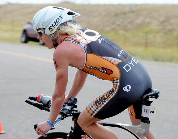 "Cameron Dye of Boulder, coming in after the bike,  won the 2012 Boulder Peak Triathlon on Sunday.<br /> For more photos and a video from the Peak Triathlon, go to  <a href=""http://www.dailycamera.com"">http://www.dailycamera.com</a>.<br /> Cliff Grassmick / July 8, 2012"