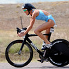 "Olympian, Laura Bennett, finishes the bike leg to go on and win the women's pro division of the Boulder Peak Triathlon on Sunday at the Boulder Reservoir.<br /> For more photos and a video from the Peak Triathlon, go to  <a href=""http://www.dailycamera.com"">http://www.dailycamera.com</a>.<br /> Cliff Grassmick / July 8, 2012"