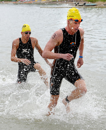 "Pro division winner, Cameron Dye, left, comes out of Boulder Reservoir on Sunday.<br /> For more photos and a video from the Peak Triathlon, go to  <a href=""http://www.dailycamera.com"">http://www.dailycamera.com</a>.<br /> Cliff Grassmick / July 8, 2012"