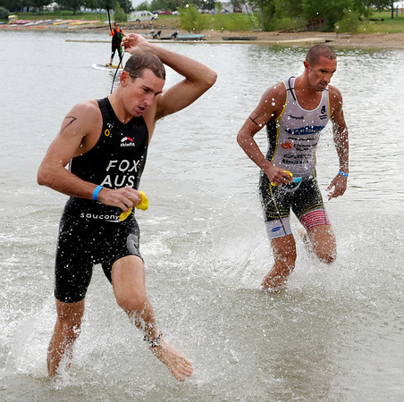 "Michael Fox, left, and Matt Reed, both of the pro division get out of Boulder Reservoir in the Boulder Peak Triathlon.<br /> For more photos and a video from the Peak Triathlon, go to  <a href=""http://www.dailycamera.com"">http://www.dailycamera.com</a>.<br /> Cliff Grassmick / July 8, 2012"
