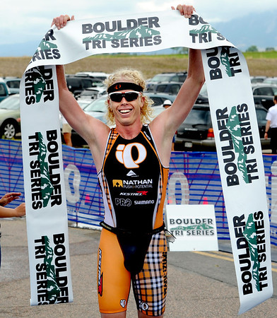 "Cameron Dye of Boulder wins the 2012 Boulder Peak Triathlon on Sunday.<br /> For more photos and a video from the Peak Triathlon, go to  <a href=""http://www.dailycamera.com"">http://www.dailycamera.com</a>.<br /> Cliff Grassmick / July 8, 2012"
