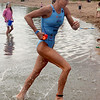 "Olympian, Laura Bennett, leaves the water to go on and win the women's pro division of the Boulder Peak Triathlon on Sunday at the Boulder Reservoir.<br /> For more photos and a video from the Peak Triathlon, go to  <a href=""http://www.dailycamera.com"">http://www.dailycamera.com</a>.<br /> Cliff Grassmick / July 8, 2012"