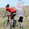 "Ben Tucker rides by his biggest supporter, his girlfriend, Jen Pierce.<br /> For more photos and a video from the Peak Triathlon, go to  <a href=""http://www.dailycamera.com"">http://www.dailycamera.com</a>.<br /> Cliff Grassmick / July 8, 2012"