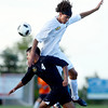 Broomfield high school's Colton Lamb, right, heads the ball over Hotchkiss high school's Irvin Hernandez, No. 4, on Wednesday, July 25, during the boys All-Star soccer game at Shea Stadium in Highlands Ranch. <br /> Jeremy Papasso/ Camera