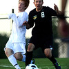 Peak to Peak High School's Dylan Thompson, left, fights for the ball with Doherty High School's Trenton Thiefoldt on Wednesday, July 25, during the boys All-Star soccer game at Shea Stadium in Highlands Ranch. Jeremy Papasso/ Camera