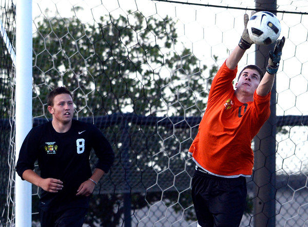 Centaurus High School's Ryan Ebersole makes a leaping save over Trenton Thiefoldt, No. 8, on Wednesday, July 25, during the boys All-Star soccer game at Shea Stadium in Highlands Ranch.<br /> Jeremy Papasso/ Camera