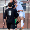 Peak to Peak high school's Ryan Urwiller, right, fights to head the ball against Grandview's Andrew Sierra on Wednesday, July 25, during the boys All-Star soccer game at Shea Stadium in Highlands Ranch.<br /> Jeremy Papasso/ Camera