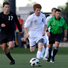 Peak to Peak high school's Dylan Thompson moves the ball upfield past Pine Creek's J.J. Meyer, No. 17, on Wednesday, July 25, during the boys All-Star soccer game at Shea Stadium in Highlands Ranch.<br /> Jeremy Papasso/ Camera