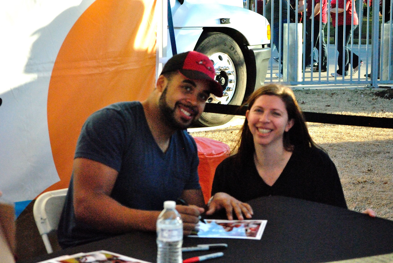 DJ Williams signing an autograph for Shannon.