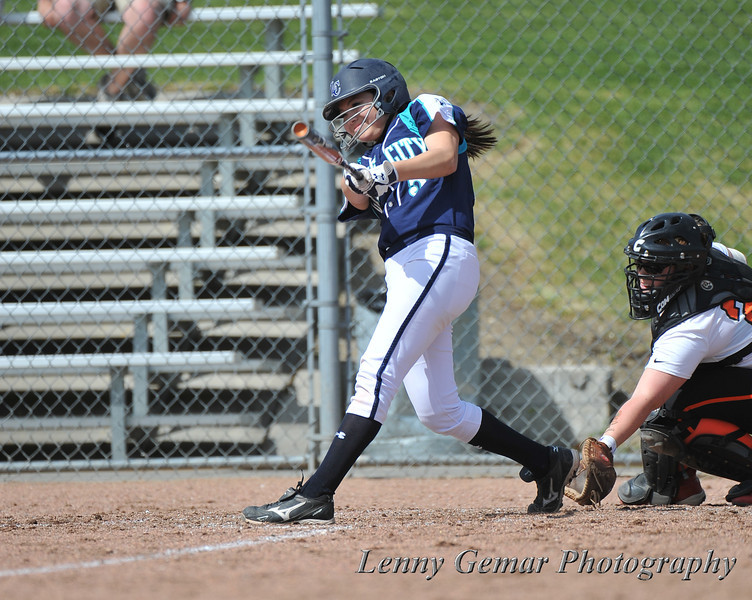 #5 Hailey Jackson hits a home run.