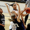 "Legacy High School's Kailey Edwards takes a shot over Highland Ranch's Shelby Hickey during a Colorado State Semifinals game against Highlands Ranch High School on Wednesday, March 7,  at the Coors Event Center on the University of Colorado campus in Boulder. Legacy won the game 64-61. For more photos of the game go to  <a href=""http://www.dailycamera.com"">http://www.dailycamera.com</a><br /> Jeremy Papasso/ Camera"
