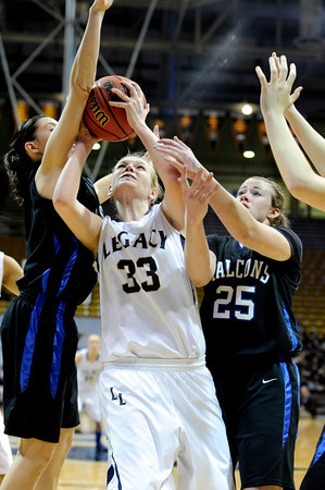 """Legacy High School's Courtney Smith goes for a shot over Highland Ranch's Kelsey Wainright, No. 25, during a Colorado State Semifinals game against Highlands Ranch High School on Wednesday, March 7,  at the Coors Event Center on the University of Colorado campus in Boulder. Legacy won the game 64-61. For more photos of the game go to  <a href=""""http://www.dailycamera.com"""">http://www.dailycamera.com</a><br /> Jeremy Papasso/ Camera"""